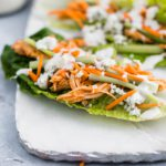 These Slow Cooker Buffalo Chicken Lettuce Wraps are super quick to get on the table. Slow cooker buffalo chicken, crisp romain leaves, celery, shredded carrot, blue cheese and ranch make a super quick, easy and healthy lunch or dinner. Perfect for meal prep.
