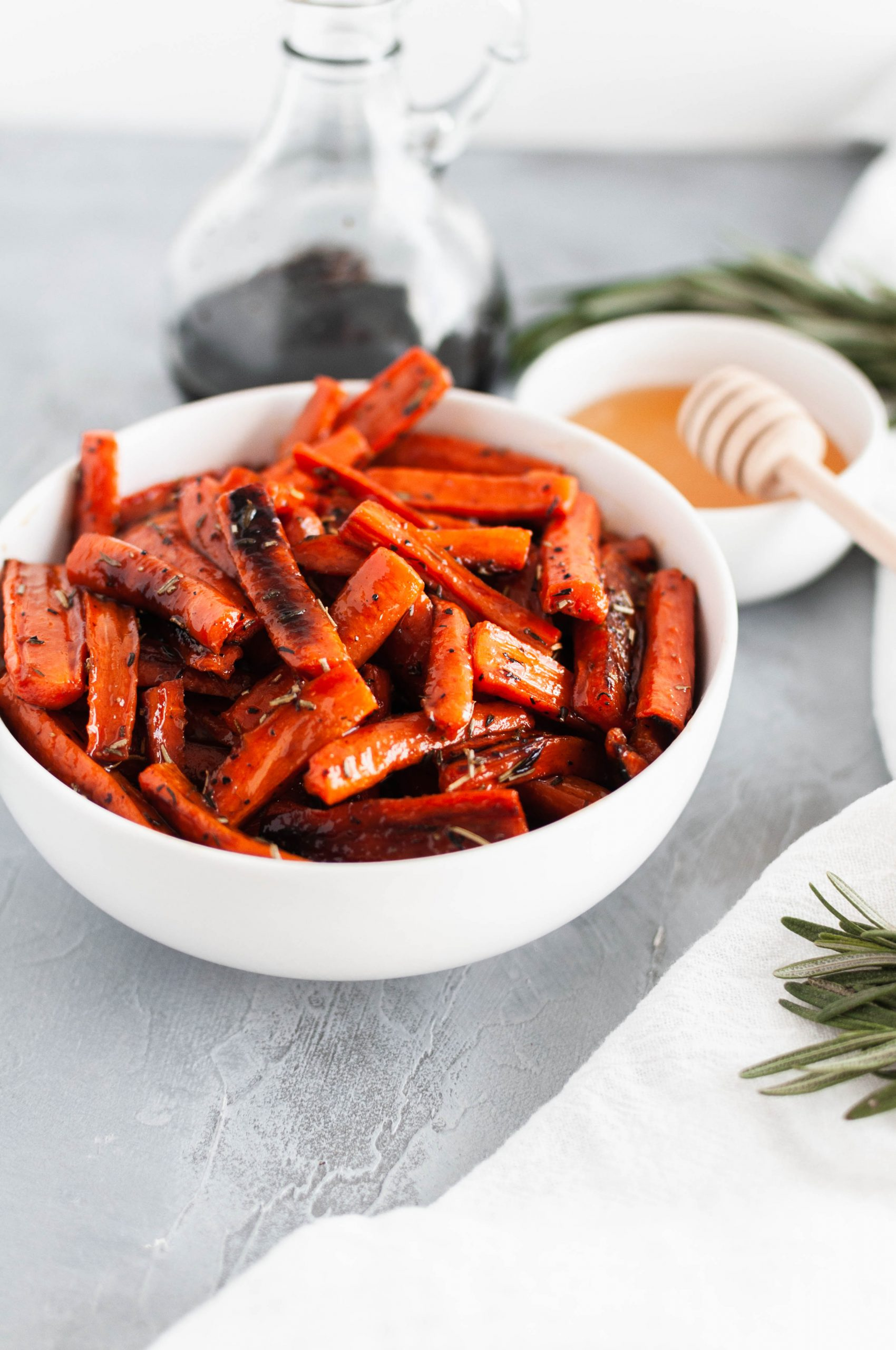 Honey Balsamic Roasted Carrots are a simple and delicious side dish for weeknights or holidays. Slightly tangy and sweet.