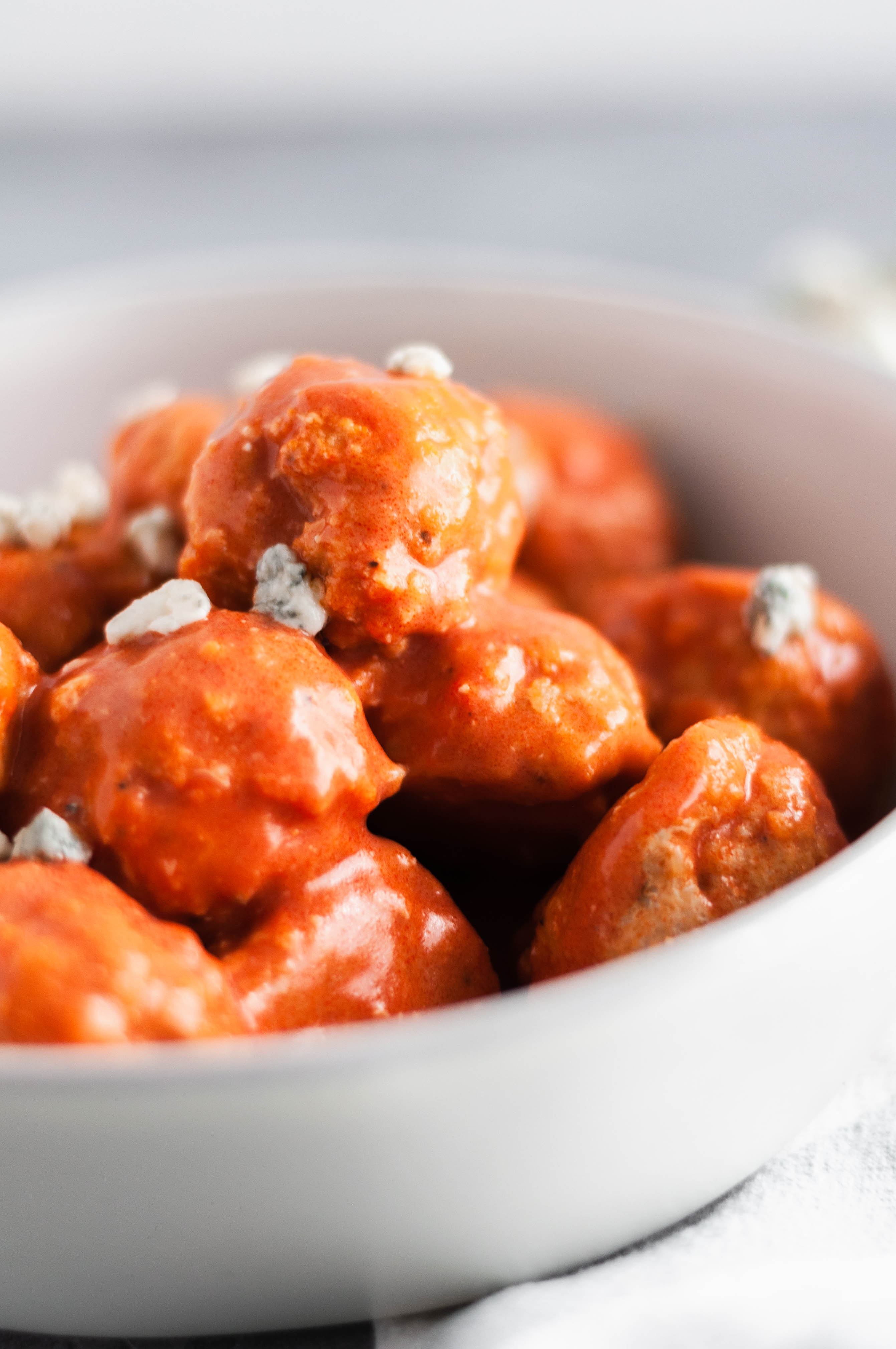 You NEED these Buffalo Chicken Meatballs for game day. Tender and spicy with a bite from the blue cheese.