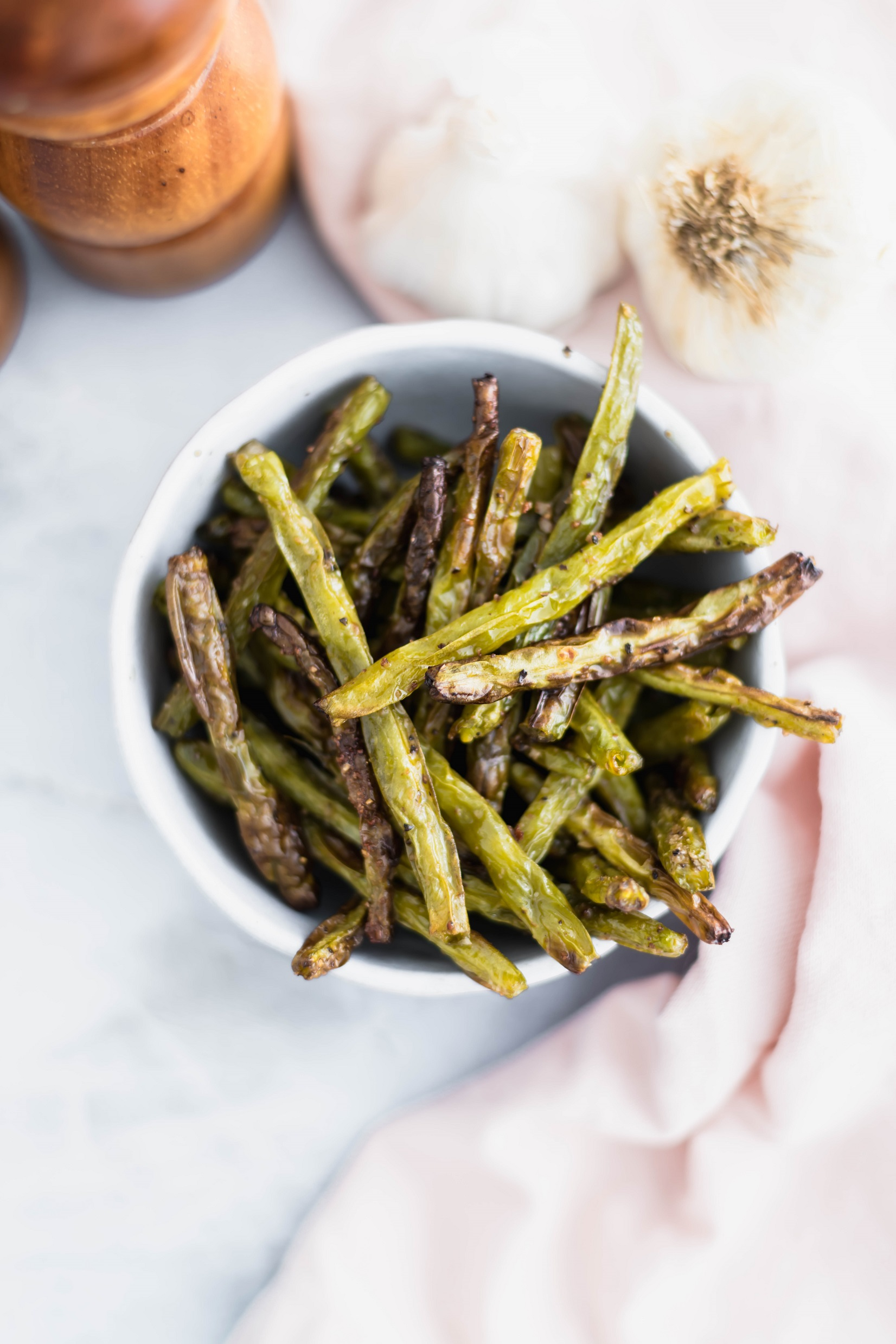 These easy Roasted Green Beans make a super easy weeknight side dish. 20 minutes from start to finish. Use fresh green beans for the most amazing flavor.