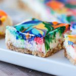 Rainbow Lemon Cheesecake Bars are a fun, festive way to celebrate St. Patrick's Day. Simple cheesecake is colored and swirled to make an adorable dessert.