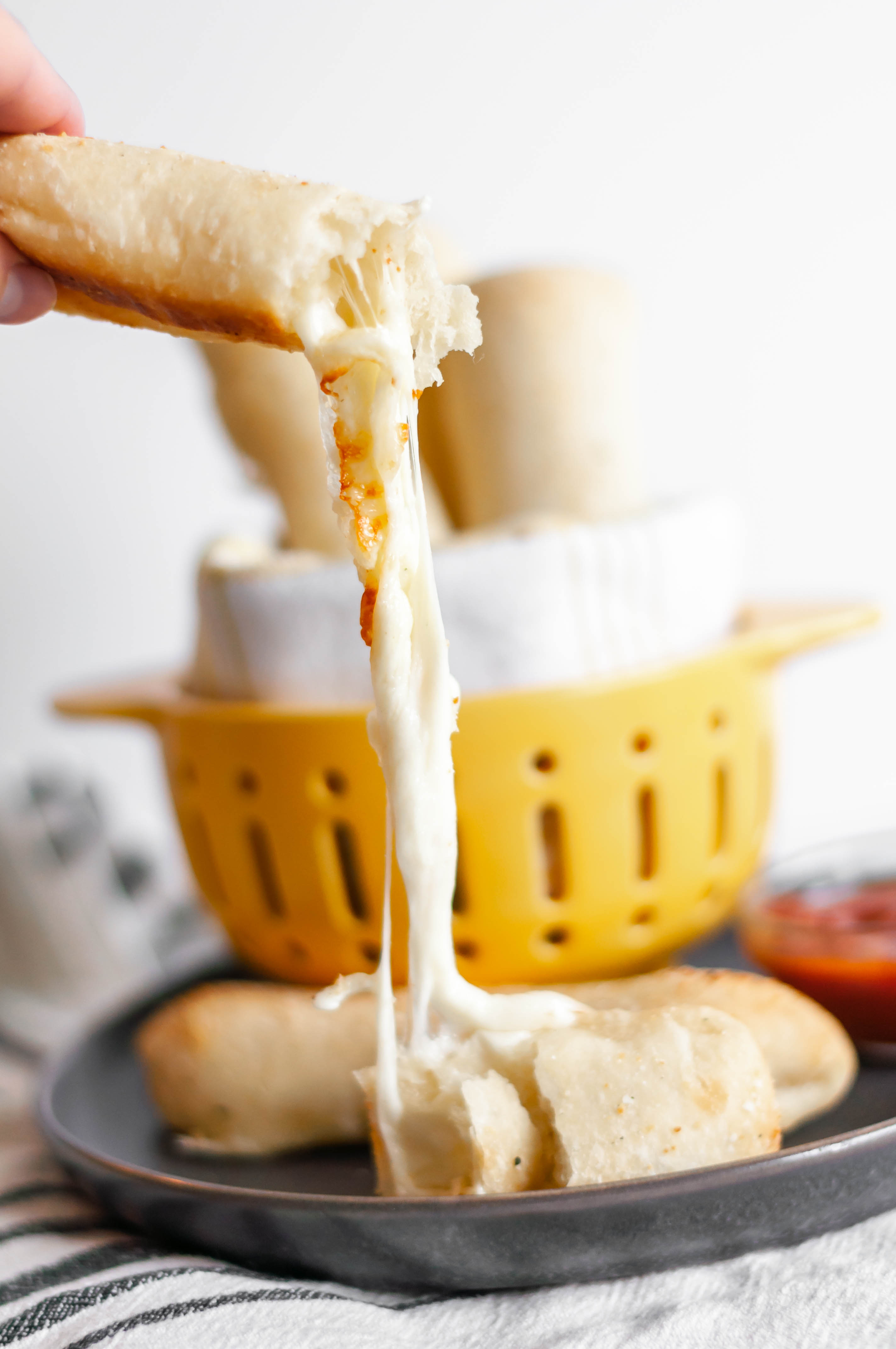 Cheese Stuffed Breadsticks are a super simple side for your soup or pasta this fall. Only 4 ingredients and less than 30 minutes for these ooey gooey cheese breadsticks.