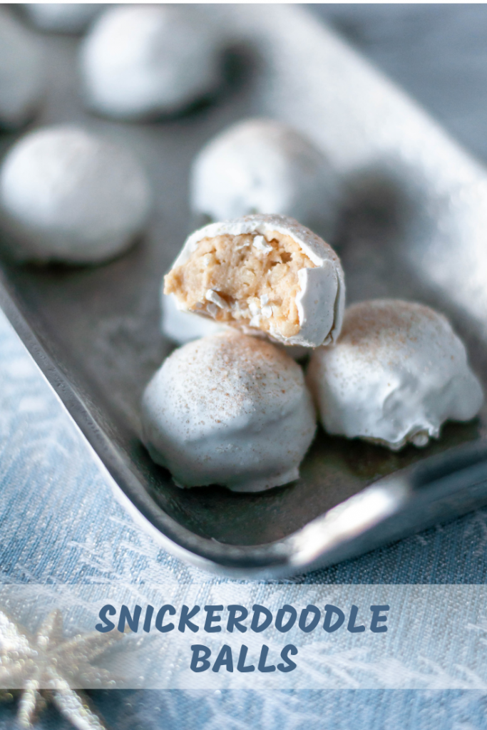 Snickerdoodle Balls are a fun spin on the classic Oreo Ball. Snickerdoodle cookies and cream cheese, dipped in white chocolate with a cinnamon sugar dusting