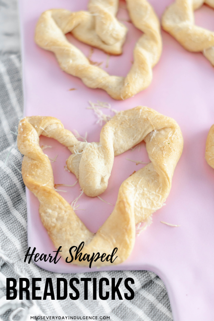 Heart Shaped Breadsticks are a simple way to add some festive flair to Valentines. Store-bought crescent dough & a few simple ingredients are all you need.