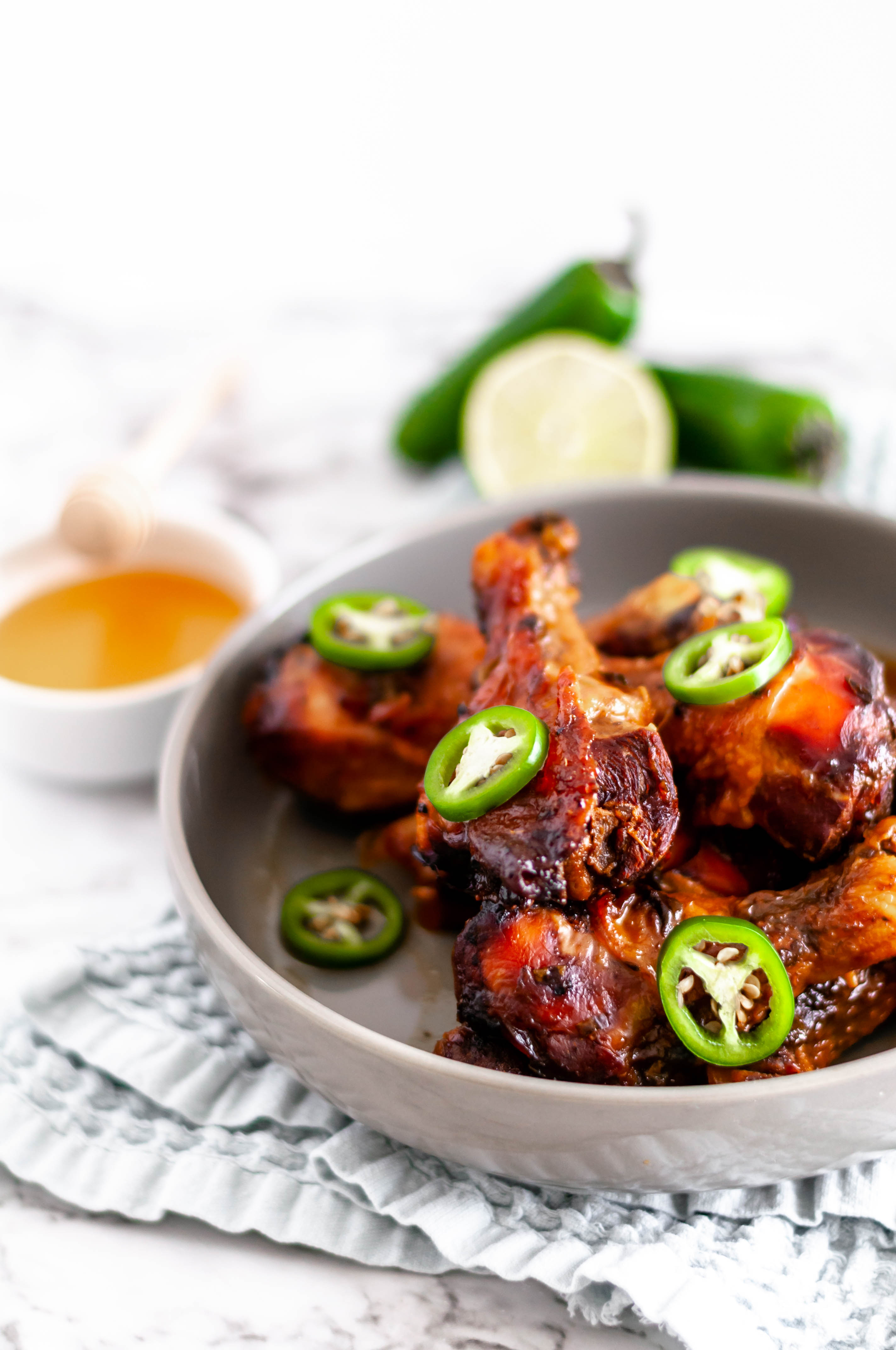 This Slow Cooker Honey Jalapeno Chicken Drumsticks are perfect for busy weeknights. Just a few ingredients tossed into the slow cooker & dinner is served.