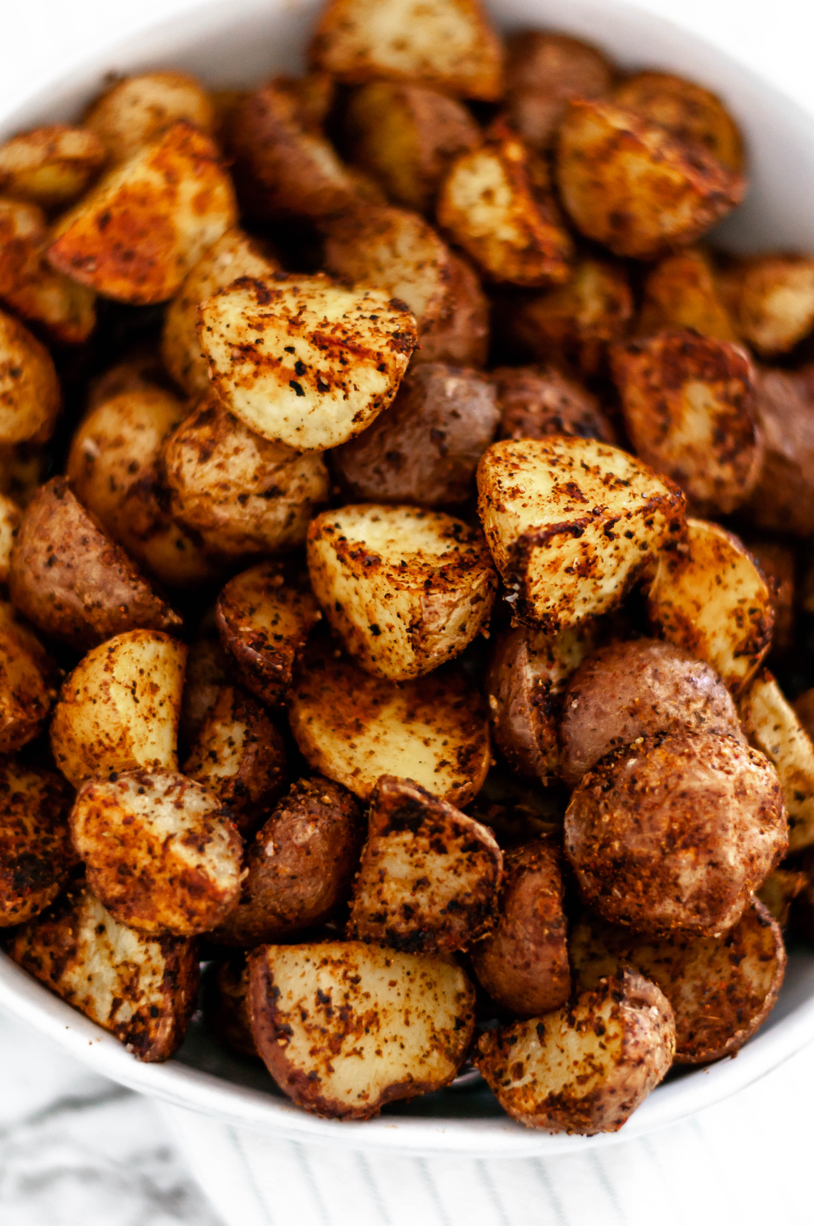 These Taco Roasted Potatoes are spiced up with your favorite taco spices. They make the perfect weeknight side dish, done in less than 30 minutes.