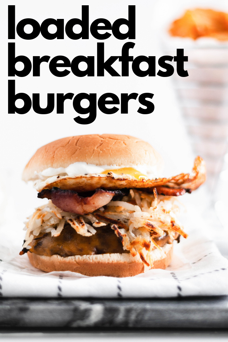 Make these Loaded Breakfast Burgers for dad this Father's Day. Juicy burgers topped with all the breakfast essentials, crispy hash browns, smoky bacon, drippy eggs and sharp cheddar cheese.