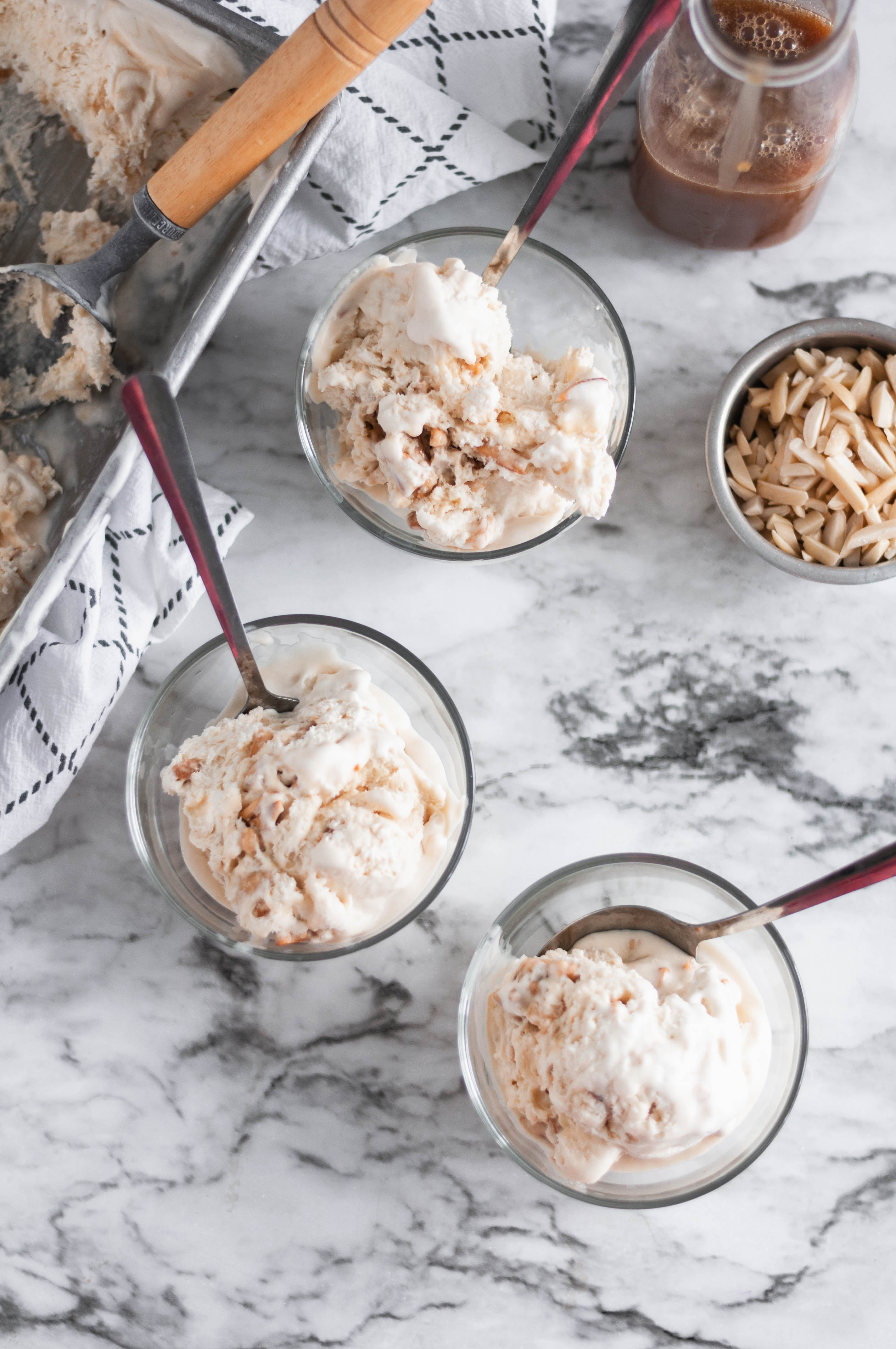 No ice cream machine needed to make this No Churn Caramel Ice Cream. It's packed with rich caramel and candied almonds for crunch.