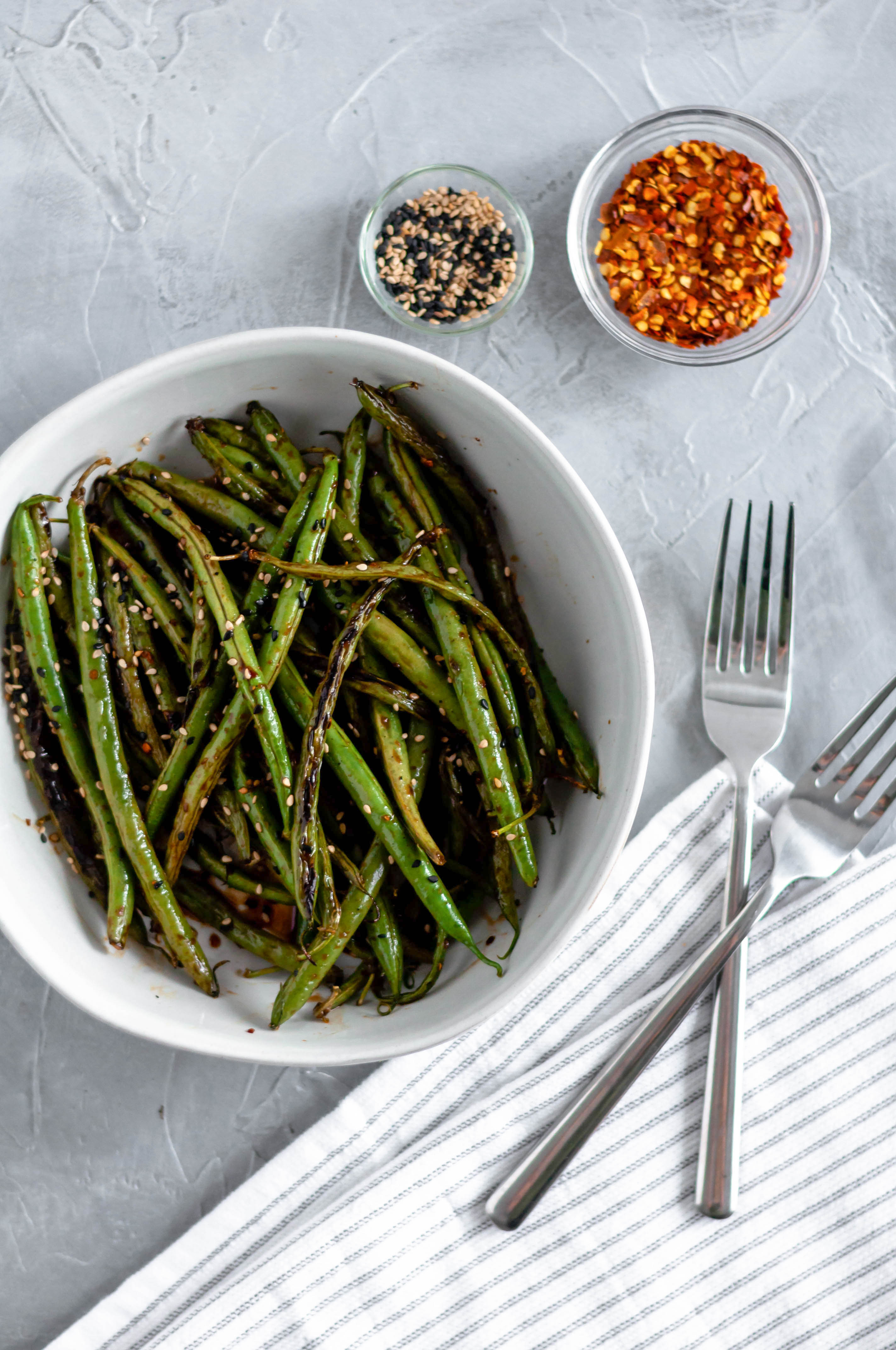 In need of a quick, simple and healthy side dish? These Asian Green Beans take minutes to make and are packed with flavor.