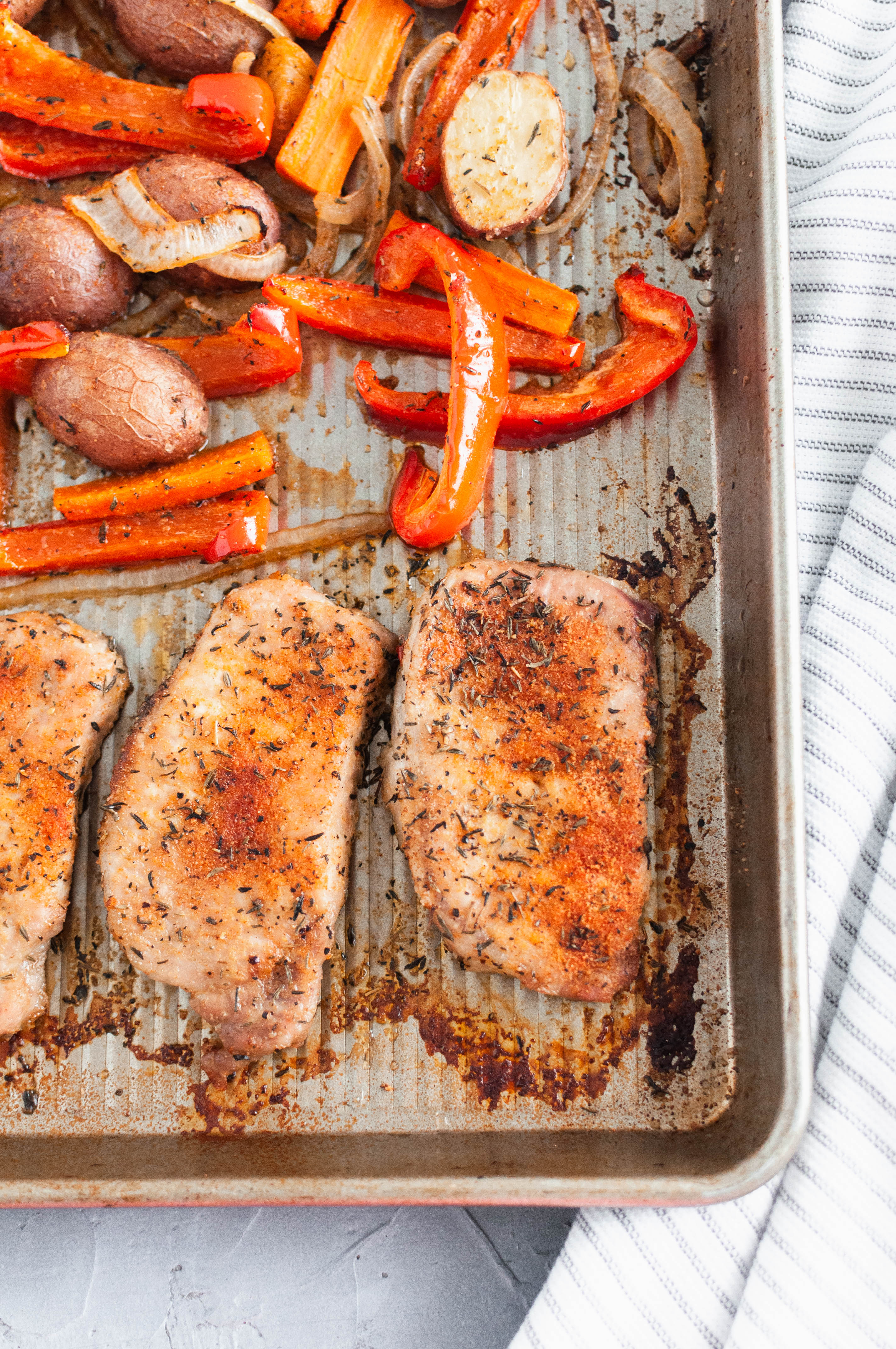 If you need a quick, simple weeknight dinner, look no further. This Sheet Pan Pork Chops and Vegetables is all cooked on one pan in less than 30 minutes and packed with flavor.