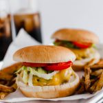 You don't need warm weather to enjoy a burger at home. These Sheet Pan Burgers and Fries are super simple to make all on one pan. A great, simple weeknight meal.