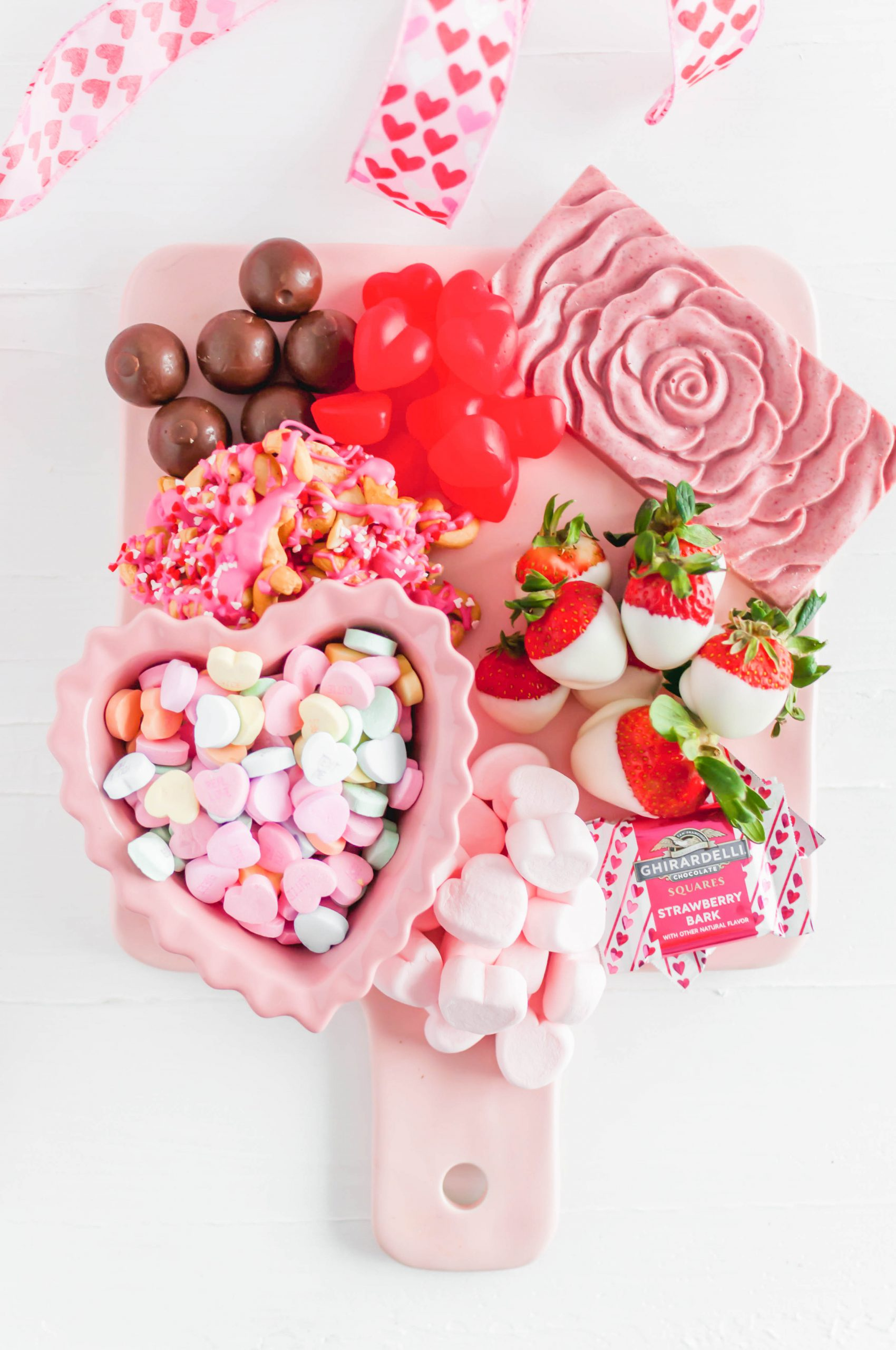 Keep your Valentine's dessert easy, fun, delicious and festive this year with this Valentine's Dessert Board. A few simple, homemade treats mixed in with some adorable store-bought options.