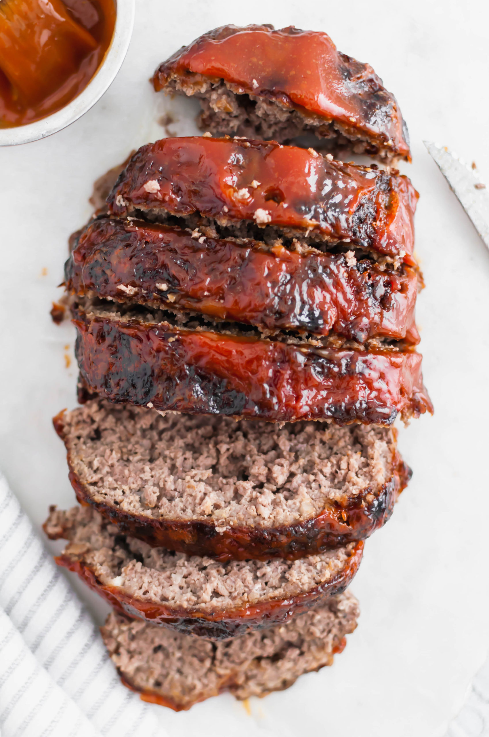 Crispy on the outside and juicy on the inside, this Air Fryer Meatloaf is simple and quick enough for a weeknight meal. Slathered with a delicious glaze to put it over the top.