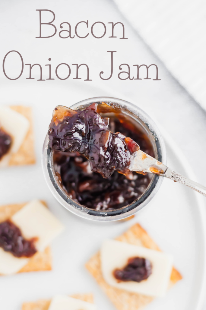 Bacon Onion Jam is a delicious, sweet and savory condiment that is going to blow your mind. Smoky bacon, red onions, sugar and vinegar are cooked down to create a thick, caramelized jam that is delicious on crackers, sandwiches, brie and more.