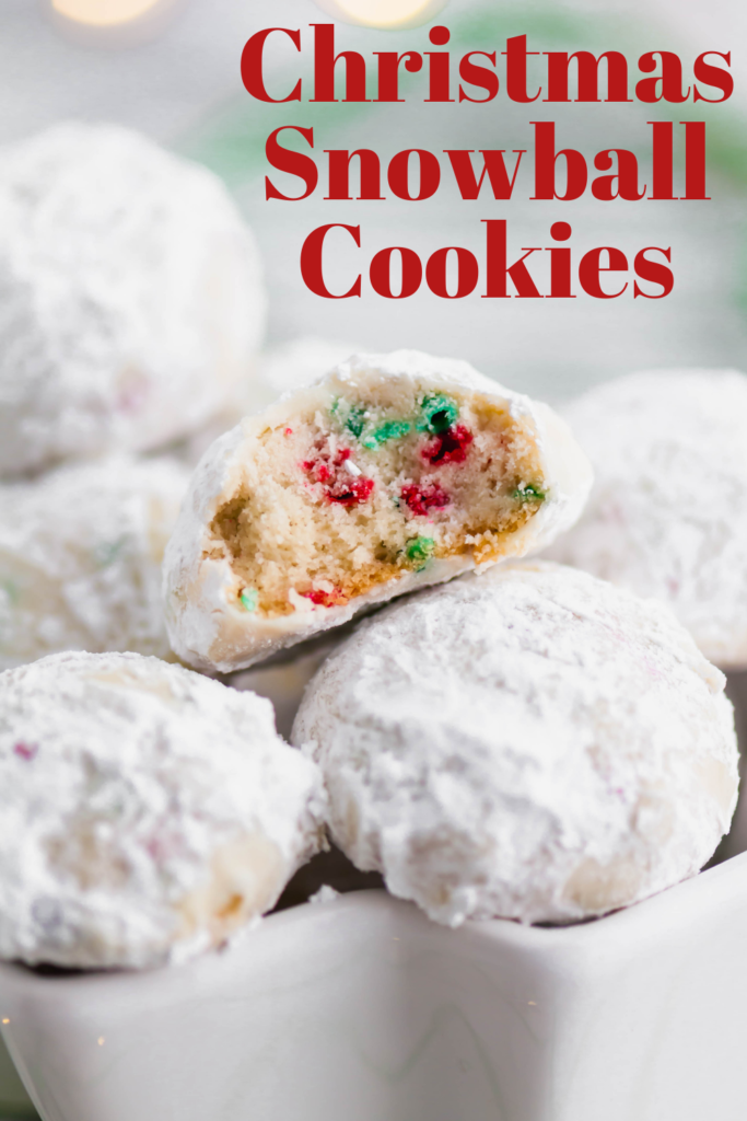 Tender, melt in your mouth Christmas Snowball Cookies are the perfect addition to your baking list this season. Super festive and fun.