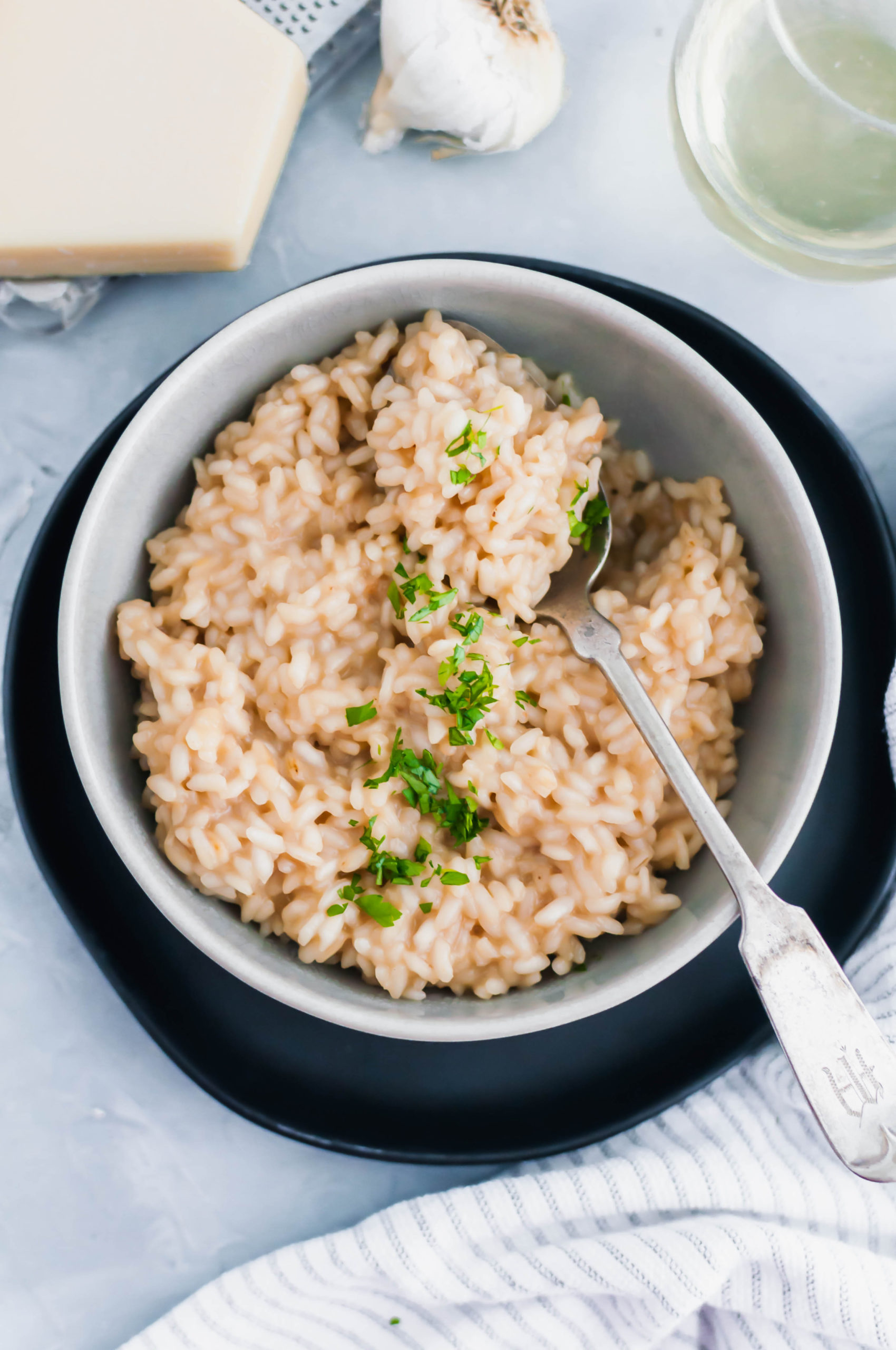 Date night in just got a little fancier with this Roasted Garlic Risotto. Simple risotto jazzed up with sweet, nutty roasted garlic.