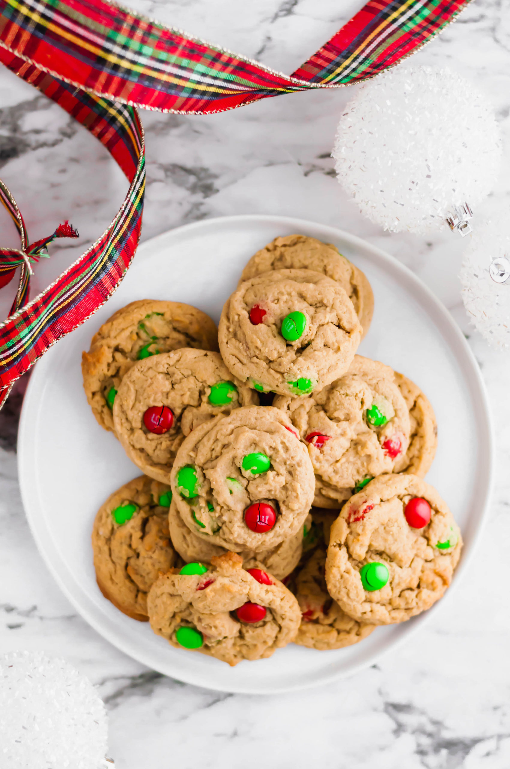 The classic peanut butter and chocolate combination is featured in these delicious Peanut Butter M&M Cookies. Perfect for all your holiday baking.