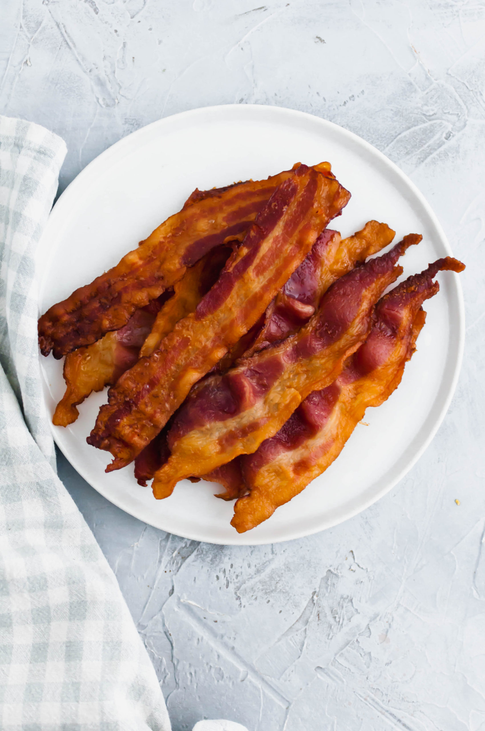 Today we're going to talk about How to Bake Bacon. It's the easiest and least messy way to prepare bacon and therefore my favorite.