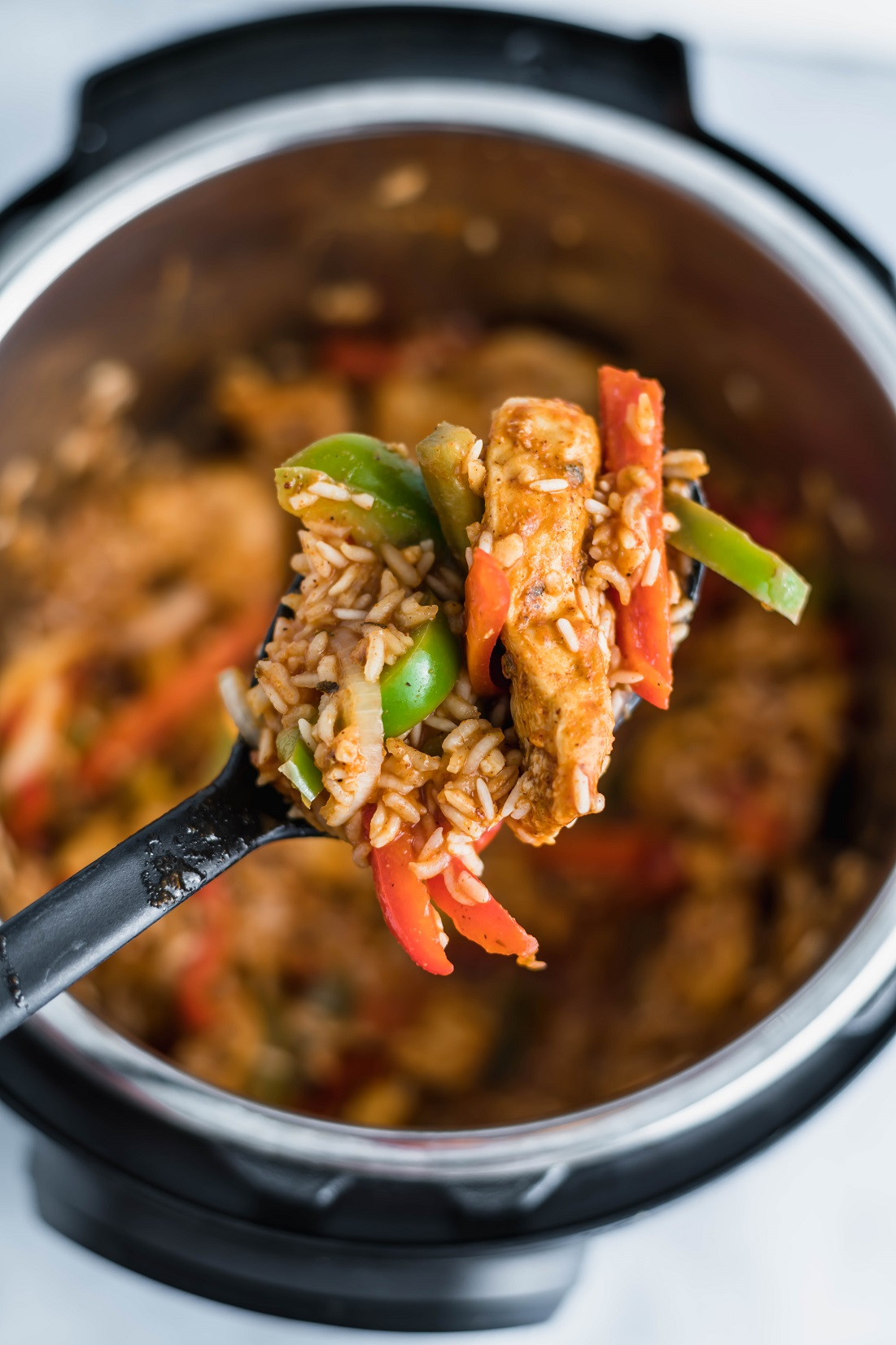 Need an easy, flavorful dinner with little effort? This Instant Pot Fajita Chicken and Rice is a meal in one pot that everyone will love.