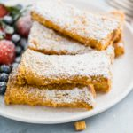These Crunchy French Toast Sticks are sure to become a family favorite. Thick cut bread cut into sticks and coated in your favorite cereal crumbs. The perfect freezer friendly breakfast.