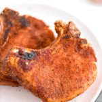 Warm weather means it's time to break out the smoker. These Smoked Pork Chops are super simple to make and done in less than 2 hours.